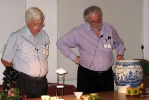 The President and Chairman discuss a pot at a Summer School